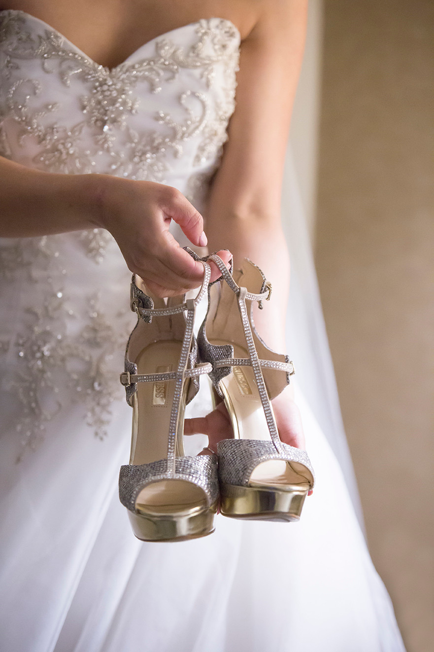 a bride showing off her wedding shoes