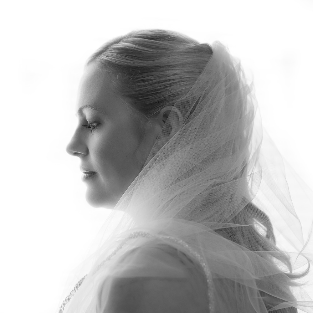a stunning black and white bridal photograph in window light