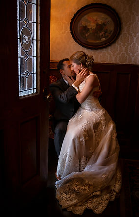 A newly wed couple embraces at the Wright House - Photographed by Rachel Leintz Photography
