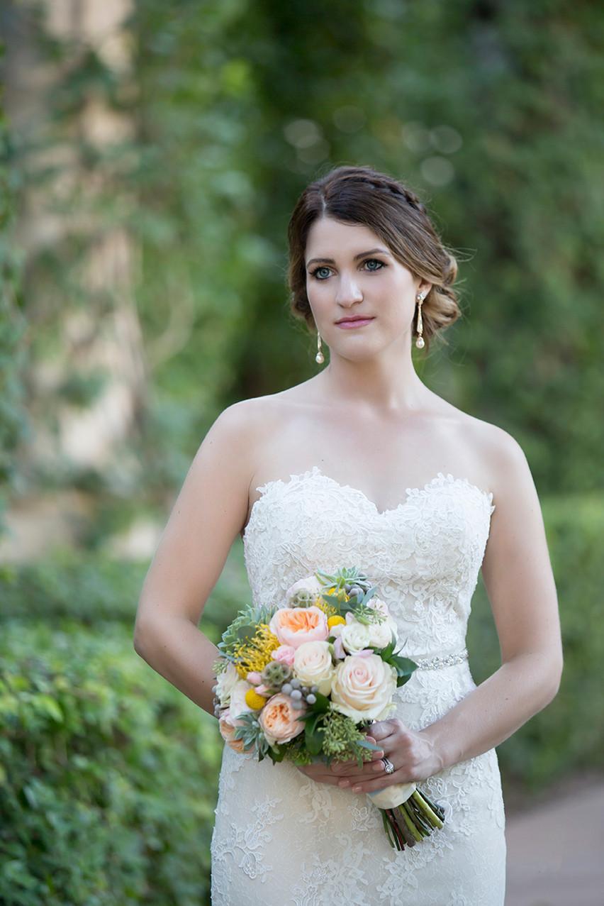 A bride looks off dreamily during a portrait session by Rachel Leintz, Wedding Photographer