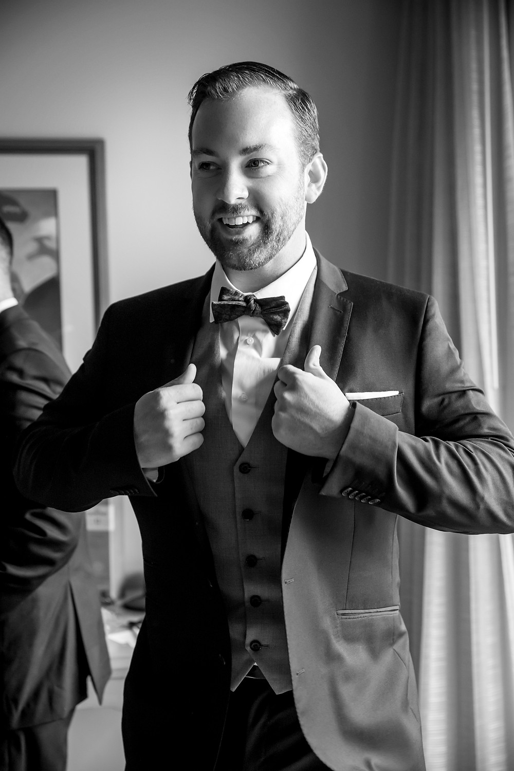 a groom smiles during his getting ready shots