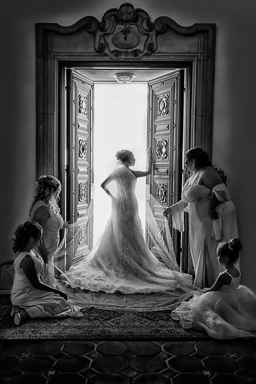 A beautiful, regal bride gets ready with her ladies in waiting