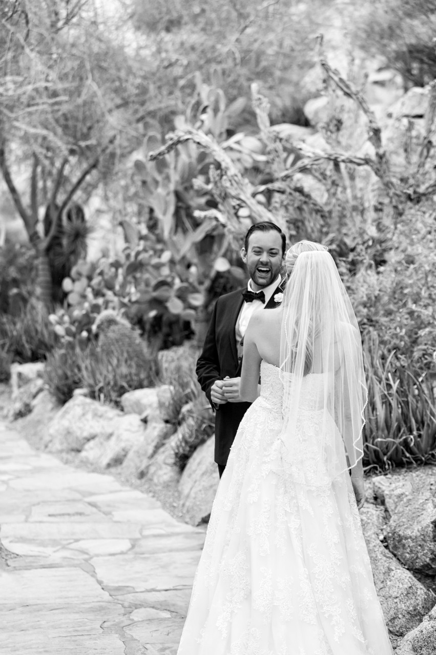 a groom sees his bride for the first time. Photograph by Rachel Leintz, Wedding Photographer