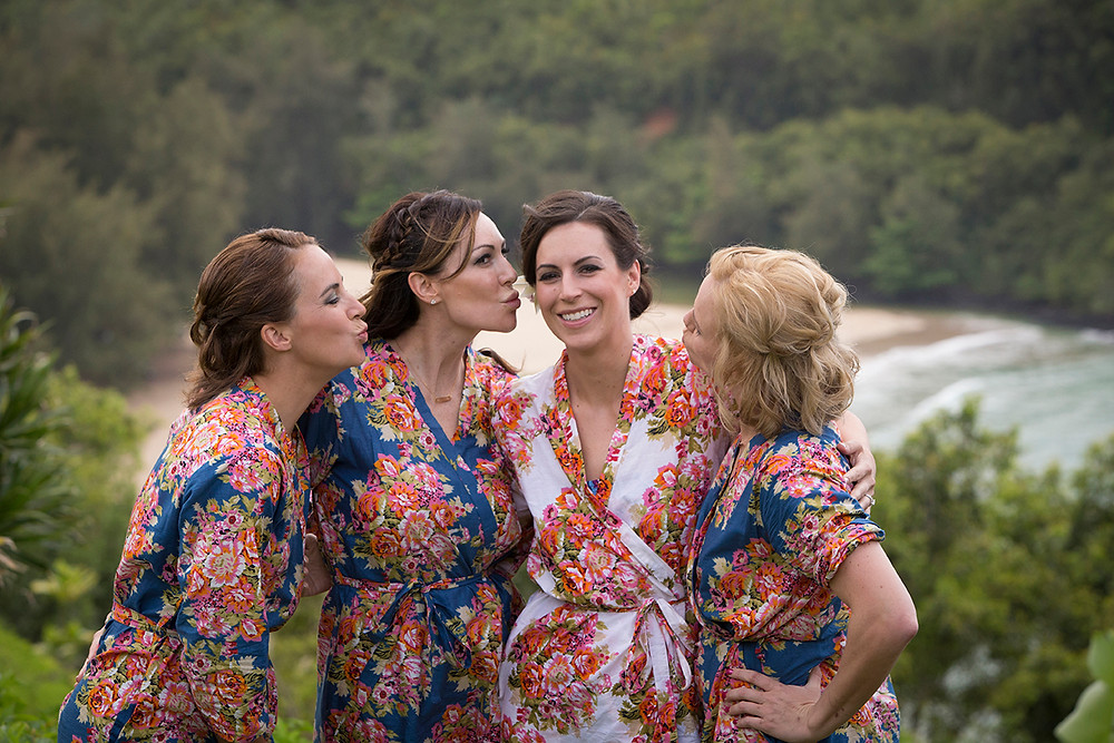 a bride and her bridesmaids in beautiful robes