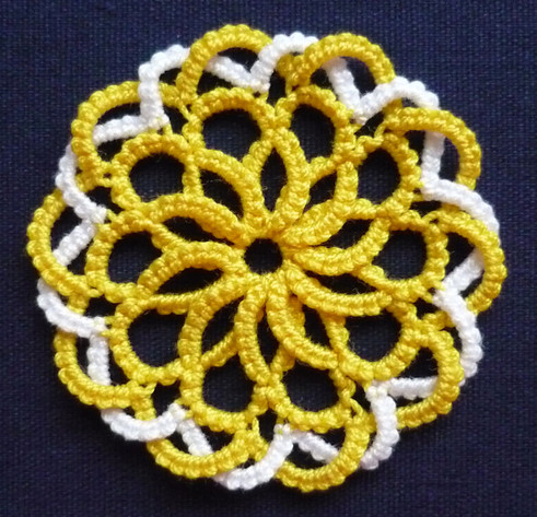 medallion with overlapped rings and chai