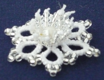 Beaded Flower motif with beaded stamens.