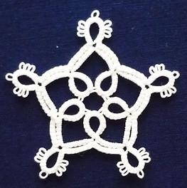 Small snowflake with mock rings.jpg