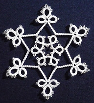 Snowflake using lock chains and beads.jp