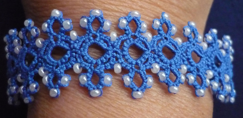 Bracelet with beads and mock rings - det