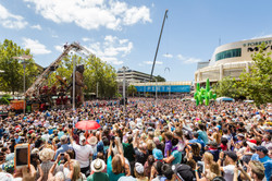 The people of Perth fill the streets as the Diver Giant takes his first steps through the city. Pert