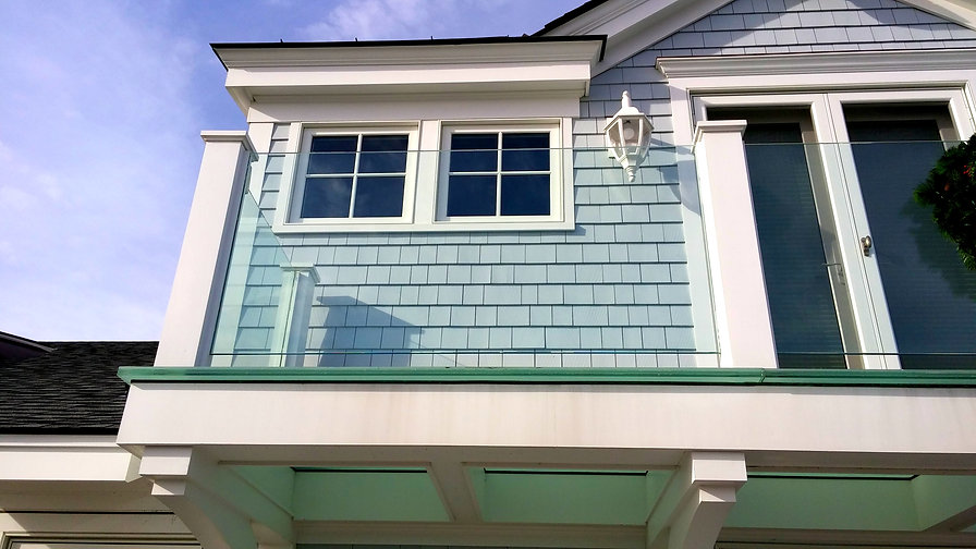 Bottle green glass floor on th deck allows lign to shine through to the kitchen below