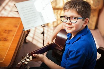 37514634_m young boy w guitar 123- purch