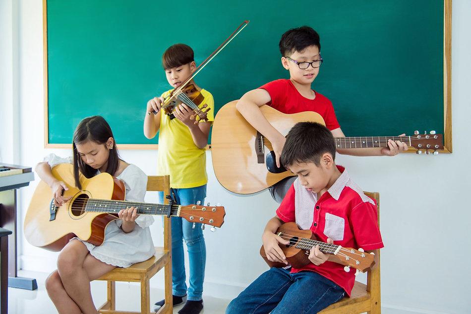 100965691_m kids playing guitar and uke