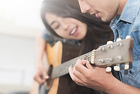 85620379_m man and woman guitar 123 - pu