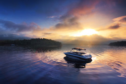 Sun and mist on a Summer , boat dock at