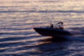 Speeding power boat on the waves.jpg