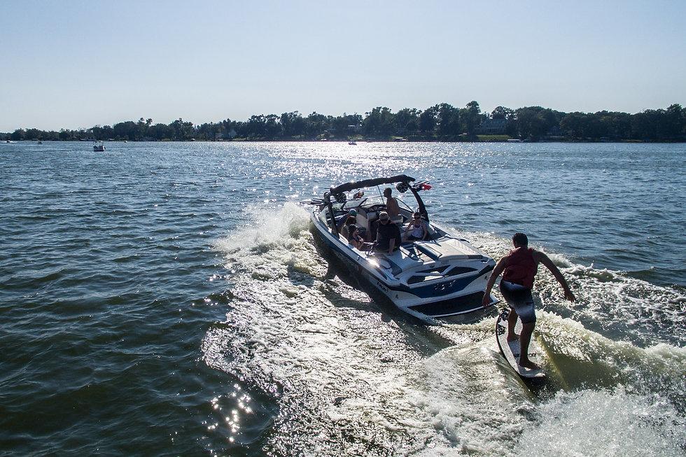 Cherokee Boat Club members wakesurfing.
