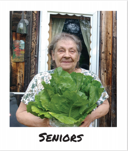 A customer of the FarmShare for Homebound Seniors holds a massive cabbage from Wyman's Farm in Milo, Maine