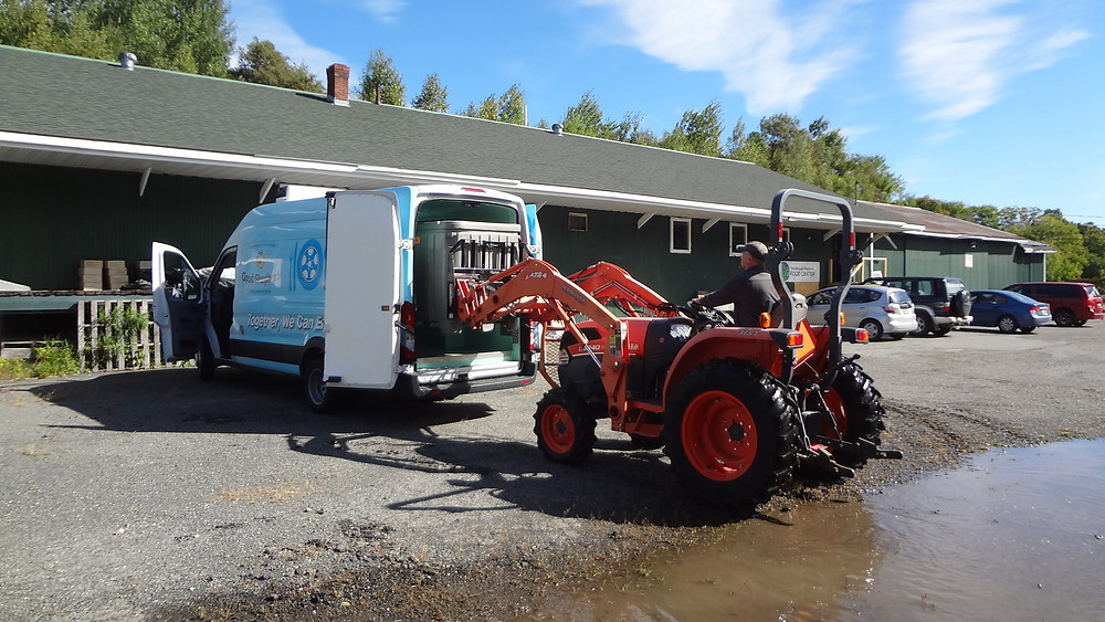Steve using tractor to load PRFC's refrigerated van