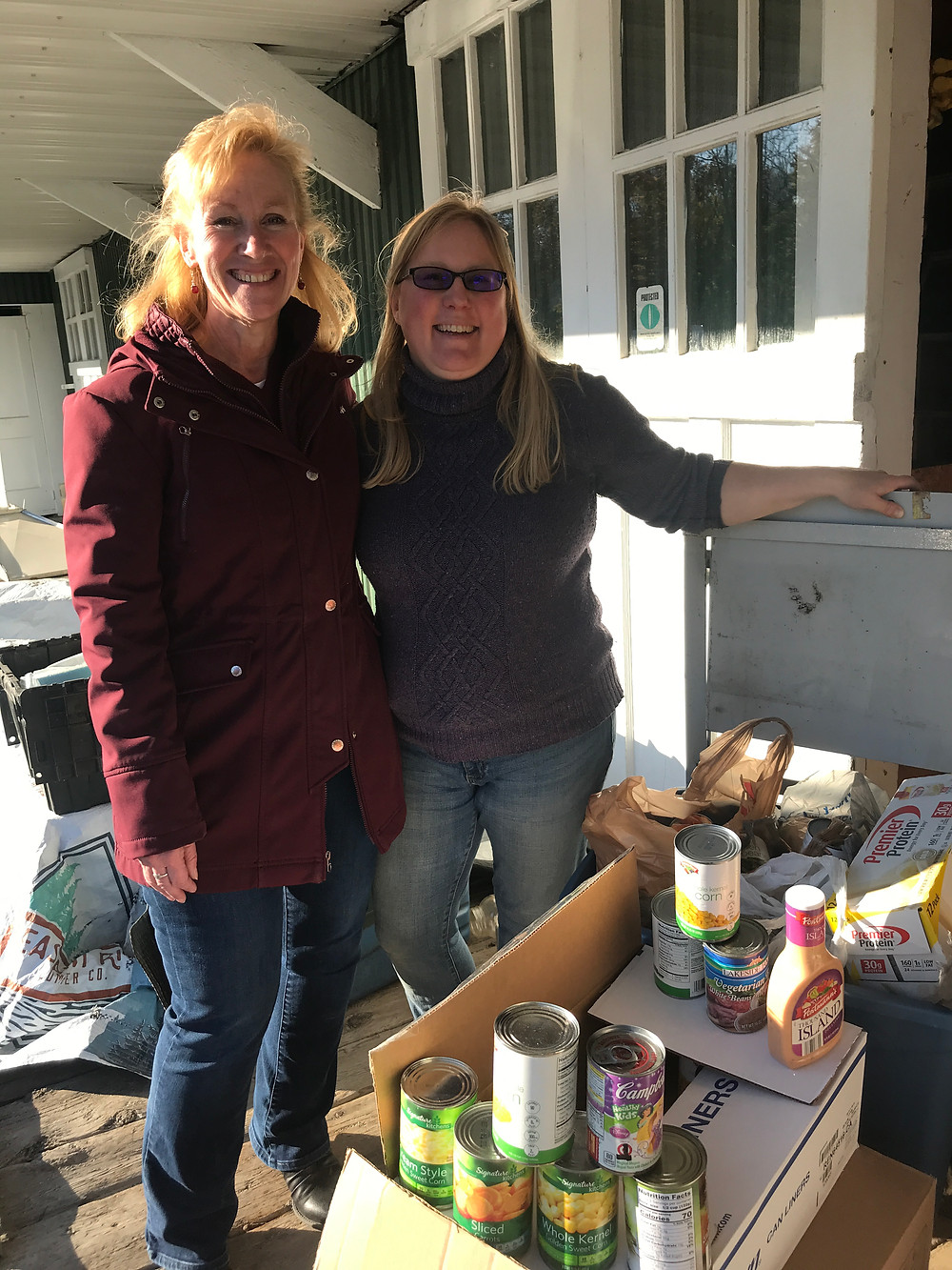 "Americorps VISTA ""TMak"" and Mrs. Hutchins with a food delivery from the SeDoMoCha 5th Grade class ""Read-A-Thon Food Drive"""