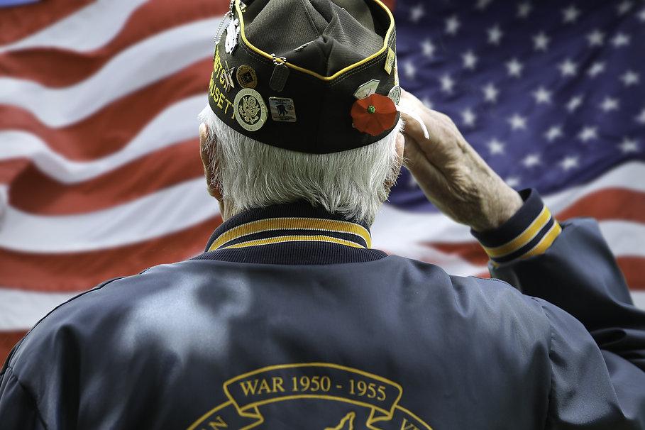 Veteran Saluting  in Front of US Flag.jp
