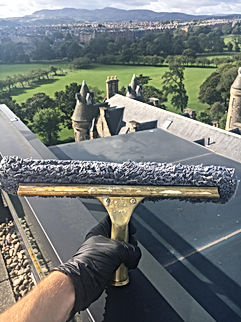 Window cleaning in Edinburgh city centre over looking the meadows