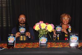 Author Alysse Daniels and illustrator Lindsey Sim Jordan Jr at the book launch table.