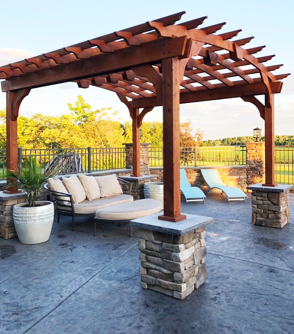 Stamped Concrete Patio with Outdoor Living Room and Pergola in Rochester NY