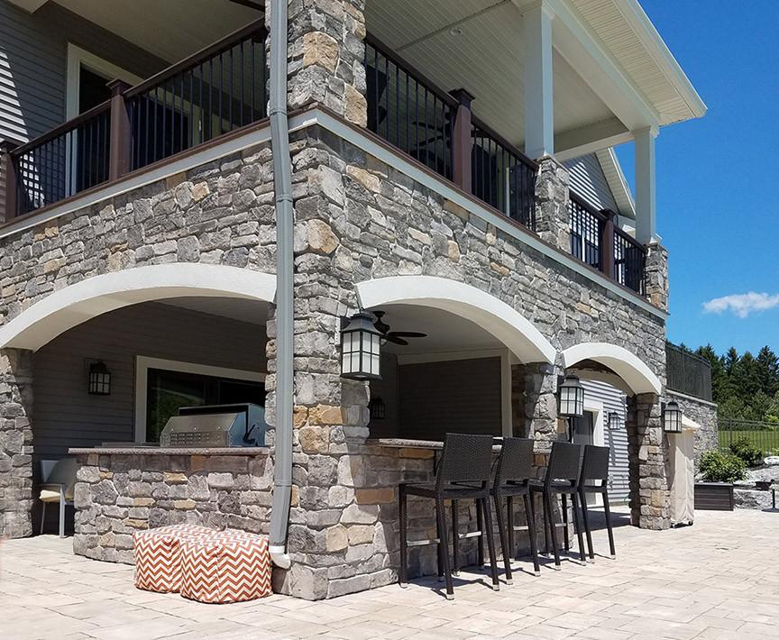 Stone veneer masonry bar and seating area