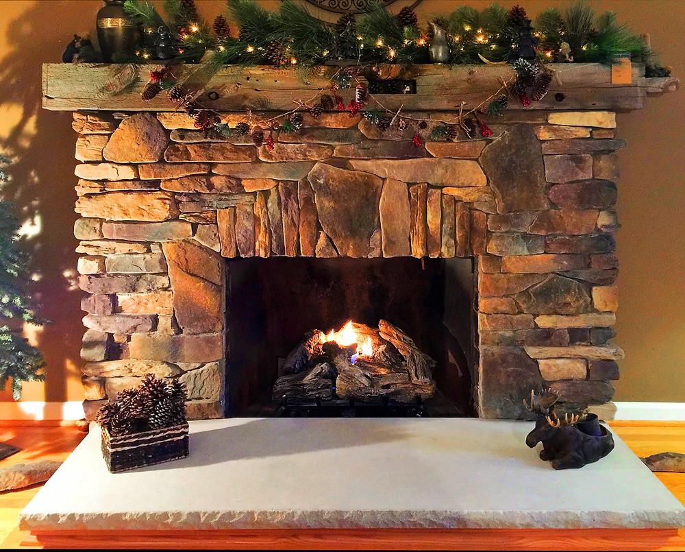 rustic stone veneer fireplace surround