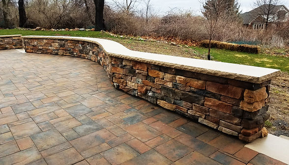 Stamped concrete patio and stone veneer