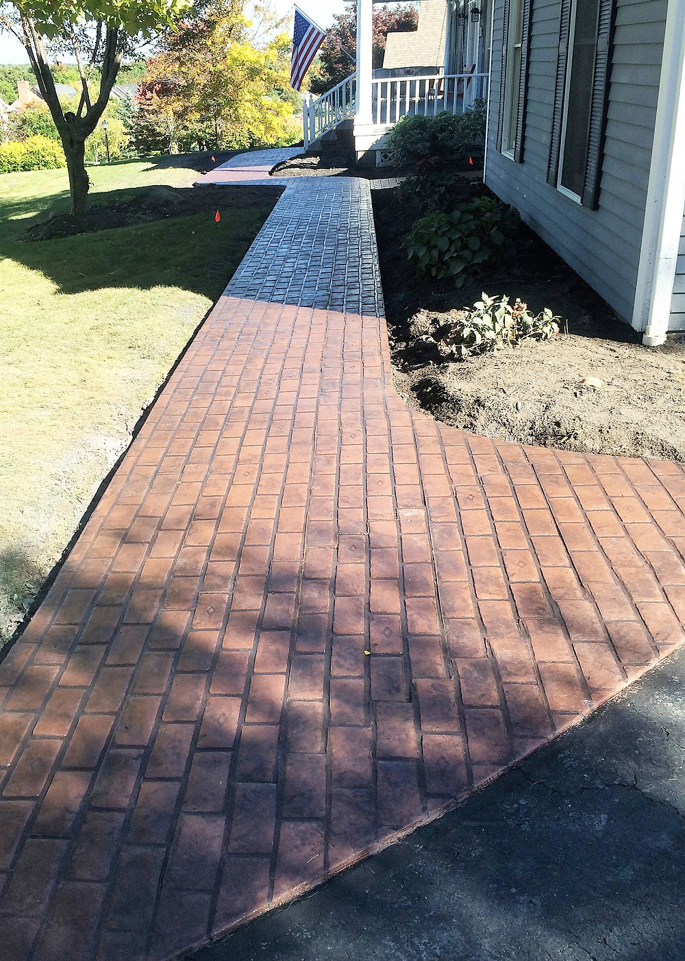 Stamped concrete walkway in Rochester ny to be made to look like brick pavers