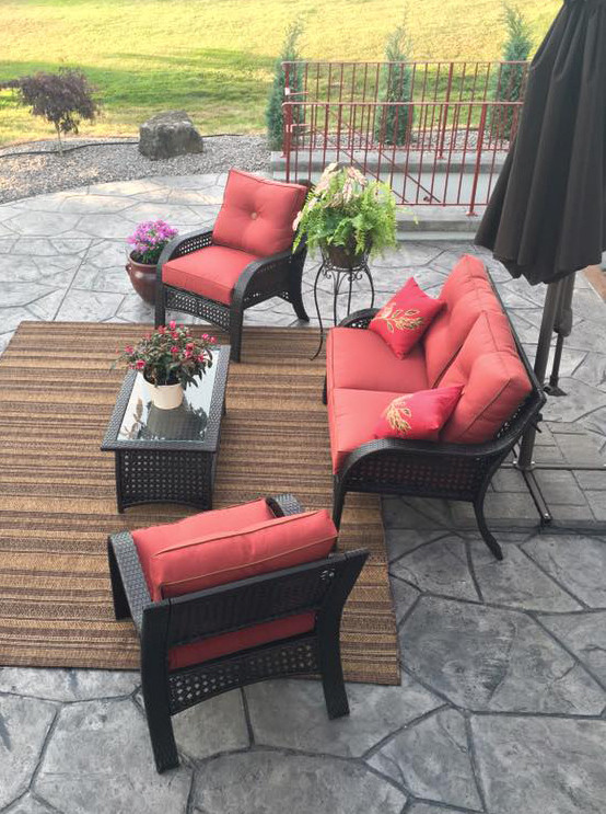 stamped concrete patio with seating