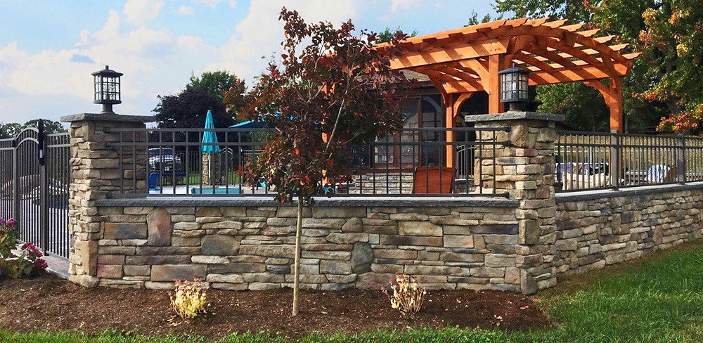 Stone Masonry Wall and Fence Surrounding Outdoor Living Area