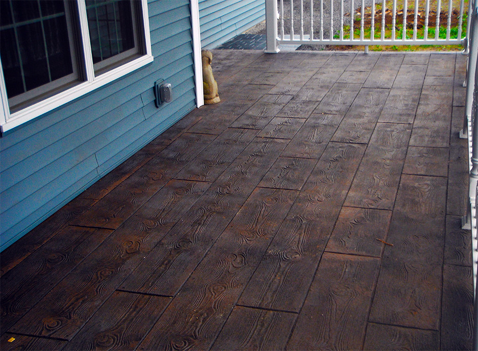 Stamped concrete on a porch in a woodgrain pattern