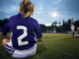 少女サッカー選手のリアビュー