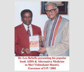 Dr. Leo Rebello presenting his popular book AIDS and Alternative Medicine to Shri Vishnuka.nt Shastri, Governor of UP, 2001