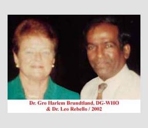 Dr. Gro Harlem Brundtland, DG-WHO and Dr. Leo Rebello, 2002.