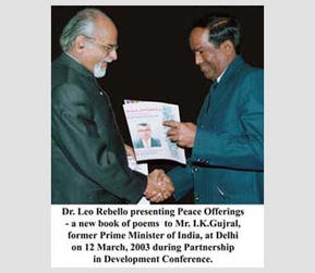 Dr. Leo Rebello presenting Peace Offerings  - a new book of poems to Mr. I.K Gujral, former Prime Minister of India, at Delhi on 12 March, 2003 during Partnership in Development Conference.
