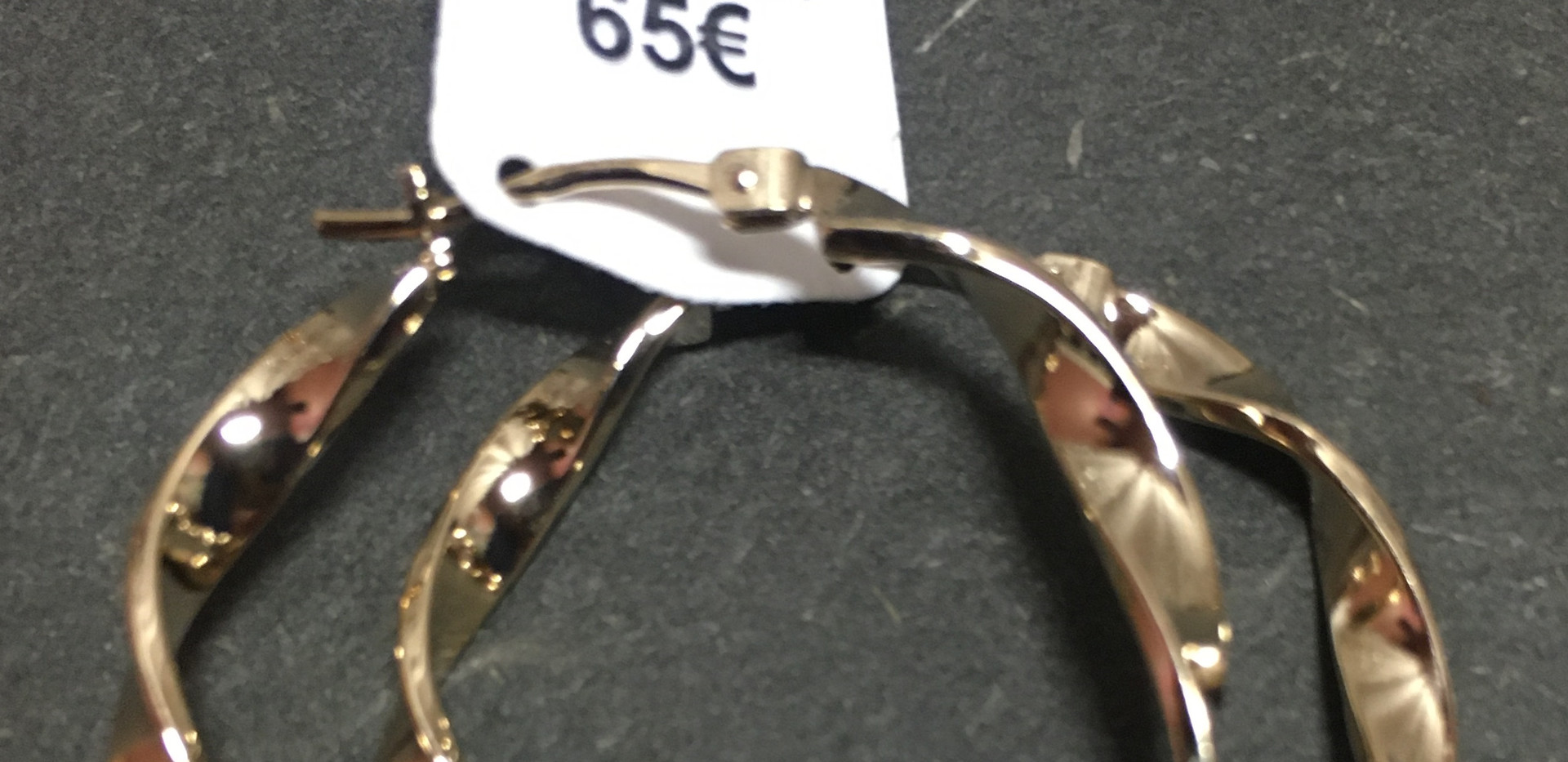 Créole fils torsadé, plaqué or jaune. France