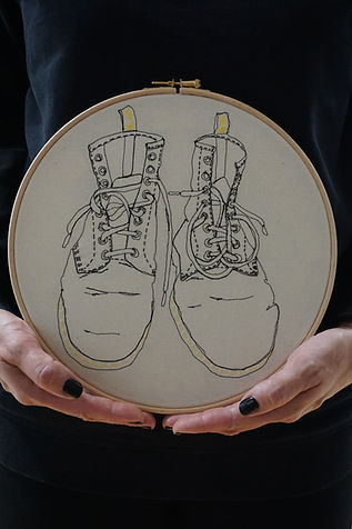 """Gemma Rappensberger holding a 10"""" Embroidered illustration of her Dr Martens boots"""