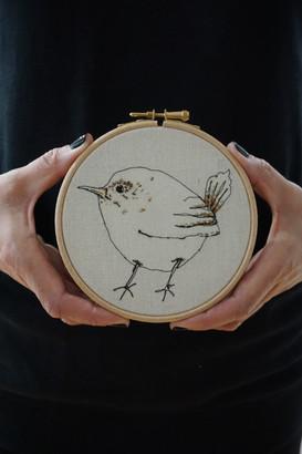 Gemma Rappensberger- an embroidered illustration of a Jenny-wren bird