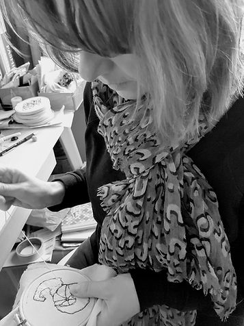 Gemma Rappensberger using hand embroidery at her desk