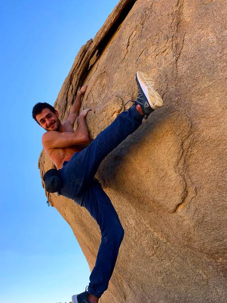Hanging off a boulder