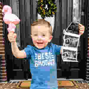 toddler pregnancy announcement with flamingo and ultrasound photo
