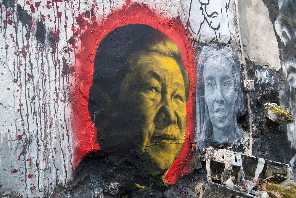 Street art of Xi Jinping with yellow and red paint