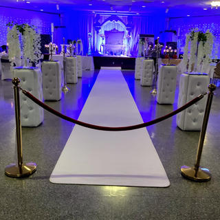 White wedding pillows used for ceremony and reception