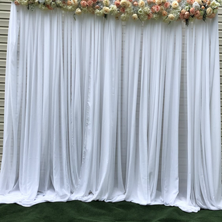 Floral runner with draping backdrop