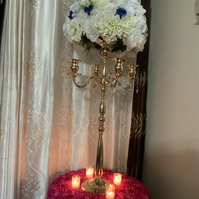 Gold candelabra use as aisle marker, and centerpieces
