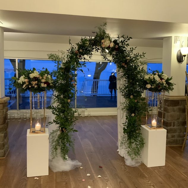 Arch garland and  Columns Floral arrangements